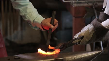 forging sword : Forge iron in the forge on the anvil. Stock Footage