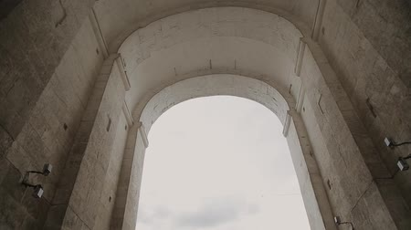 flavian : Span with steadicam under stone arch. Stock Footage