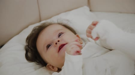 получать : Beautiful little girl woke up and smiles at the camera