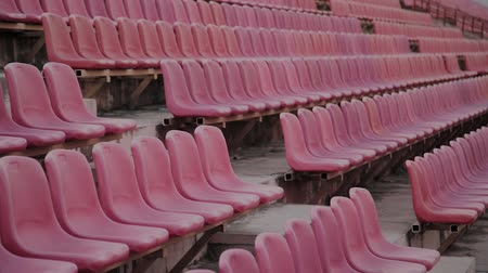 arquibancadas : Empty red sports stadium seating before a big game.
