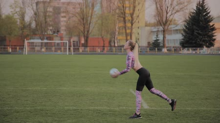 legs only : Young beautiful girl playing with a ball at the stadium. Stock Footage