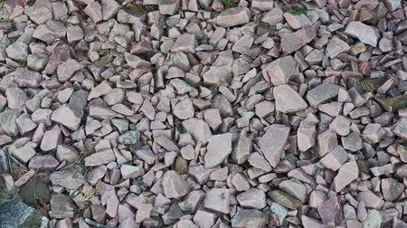 macadam : Crushed stone. crushed stone of two colors. gravel. Close-up