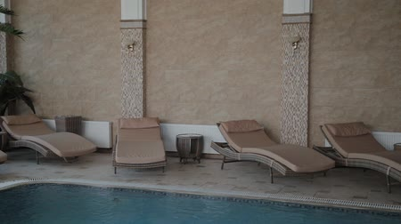 deck chairs : Stylish loungers by the indoor pool. Stock Footage