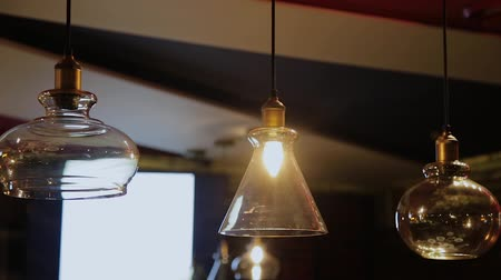 adega : Vintage and retro yellow light bulb hanging over dark background in cafe at night. Many luxury light lamp decorative industrial loft style in bistro and restaurant. Vídeos