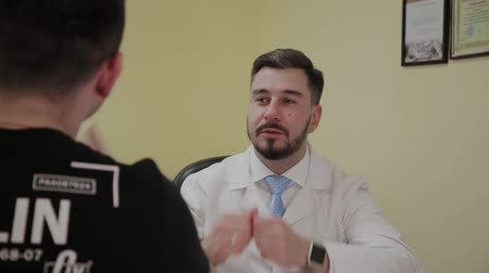 human heart : Male doctor takes a patient in his office. Stock Footage