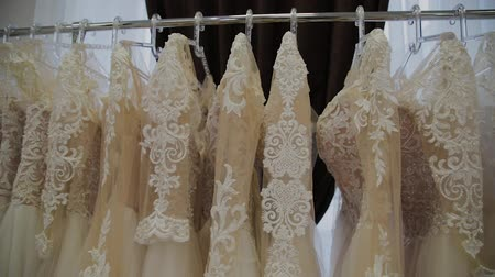 vállfa : Beautiful wedding dresses in a bridal salon. Stock mozgókép