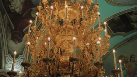 viktoriánus : Big bronze chandelier in cathedral christian church.