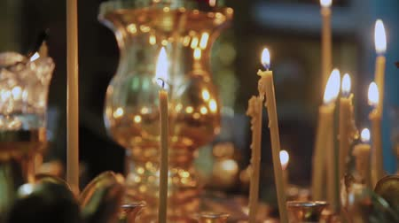 holy book : Candles on a candlestick in a church. Religious holiday. Stock Footage
