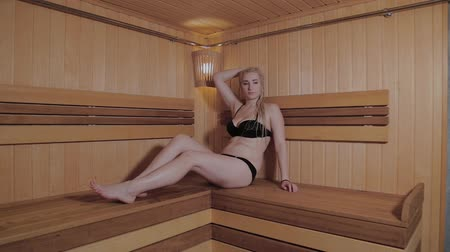 bagno di vapore : Beautiful girl has a rest in a sauna.