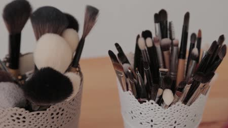 キット : Professional makeup kit in a makeup studio on a wooden table. 動画素材