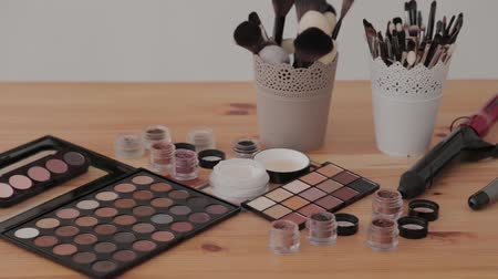 beauty products : Professional makeup kit in a makeup studio on a wooden table. Stock Footage