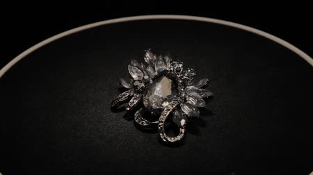bijouterie : Brooch in with stones on a black rotating stand. Premium Jewelery. Macro.
