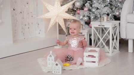 Beautiful one-year-old girl in a New Years decor. Happy New Year 2020.