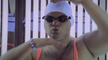 solarium : Full man sunbathes in tanning beds and dances. Stock Footage