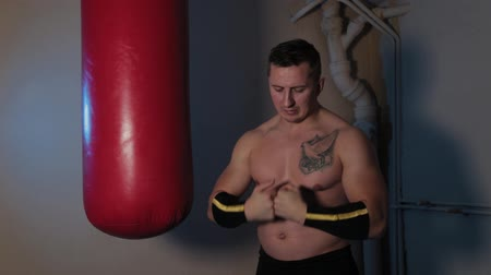 motive : Male boxer flexes his arms before training.