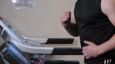 heart monitor : Professional athlete training on a treadmill.