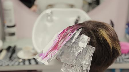 краситель : Professional hairdresser woman washes hair dye girl.