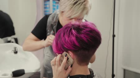 dyeing : Professional hairdresser woman styling girl after dyeing hair.