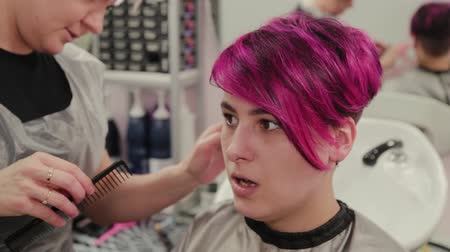 haircut : Professional hairdresser woman styling girl after dyeing hair.
