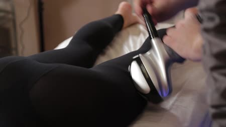 ягодицы : Professional male masseur makes a vacuum massage with a special device to a beautiful woman.