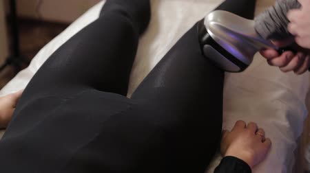 cellulite treatment : Professional male masseur makes a vacuum massage with a special device to a beautiful woman.