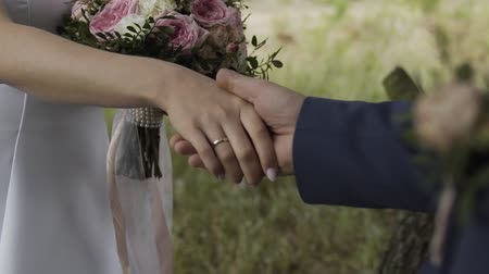 новобрачный : Happy newlyweds join hands on a wedding day.