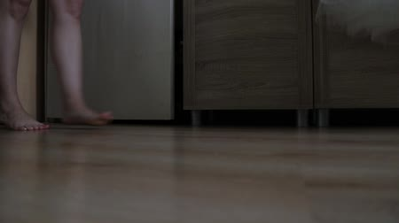 wakeup : Beautiful bare feet of a girl walk on the floor in the room.