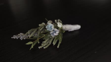 smokin : Wedding boutonniere on the table. Camera access. Stok Video