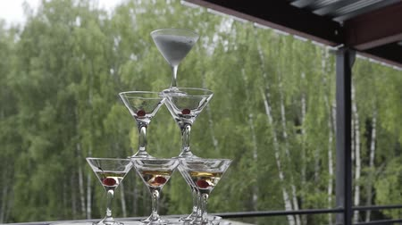 martini glasses : Beautiful champagne pyramid at a celebration for guests.