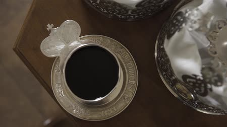 eucharystia : the priests hand baptizes a cup of wine.