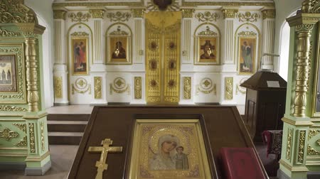 crucified : Orthodox golden cross and icon in the church. Stock Footage