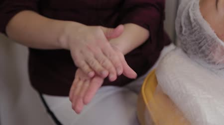 disinfectant : A nurse in rubber gloves spray a disinfectant on her hands, close-up. A nurse squirting on hand disinfectant solution. Stock Footage