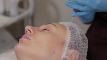 preserve : Professional beautician woman performs micronidling facial skin.