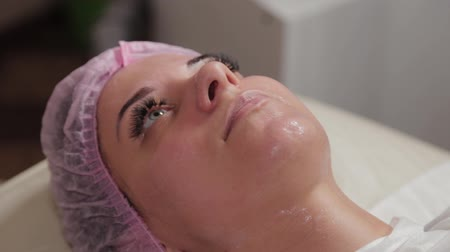 surgical mask : Beautiful young woman in a cap at the beauty parlor. Stock Footage