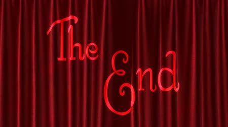 veludo : Large velvet curtains close showing the words The End projected on to them.