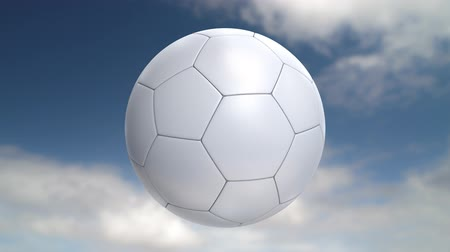 piłka nożna : Soccer ball flies at the camera then stops but keeps rotating. Last 200 frames loop. Wideo
