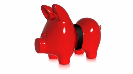 bank : A piggy bank is squeezed by a belt. Two views.