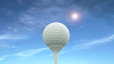 isabet : Golf ball against a blue sky is hit into the air.