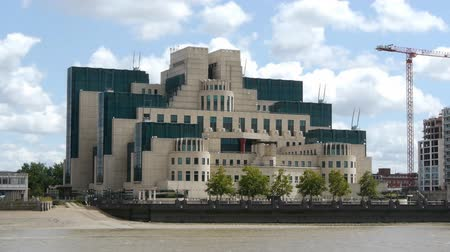 secret service : The headquarters building of the UK Secret Intelligence Service. Known as MI6 the SIS has been based at this building at Vauxhall Cross on the south bank of the Thames since 1995. The architect was Terry Farrell. Stock Footage