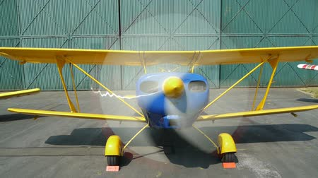pervane : Propeller of a small biplane spinning round.