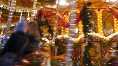 карусель : A funfair carousel at the German market at Christmastime in Birmingham city centre.