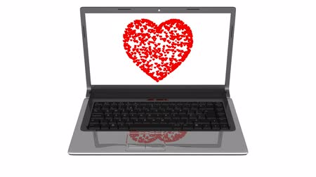 társkereső : Online Dating Heart. Red heart forms on a laptop screen. Stock mozgókép
