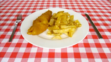 placas : Plate of fish and chips.