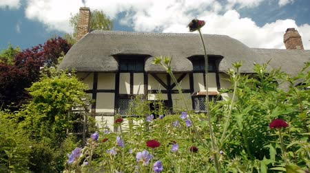 half timbered houses : Picturesque medieval half timbered cottage in the English   midlands with flowers and plants in the foreground.