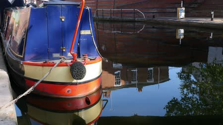 icc : Stern of a narrow boat on a canal by Birminghams   International Convention Centre.