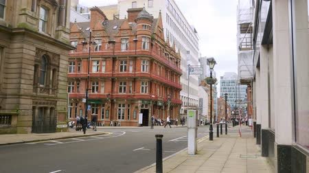 anglia : City streets, buildings and people in Birmingham, England.