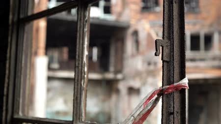 abandoned city : Rusty window frame with derelict, wrecked building background. Stock Footage