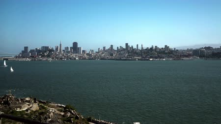 Time lapse panorama of part of the San Francisco Bay shoreline. Goes from the Golden Gate Bridge to the towers of  downtown San Francisco. Shot from Alcatraz island.