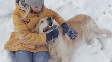 Young Girl  with dog on snow