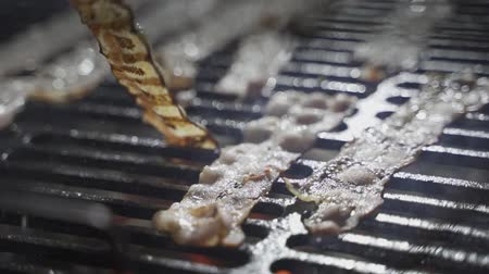 fast food : slice of bacon fried on a grill